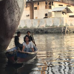 Some locals rowing from their make-shift housing to the mainland. Jakarta's port has played an important role in the city's development - from small colonial Dutch settlement to Asian megacity.